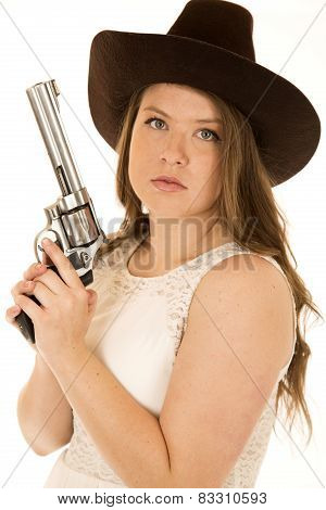 Cowgirl Holding Revolver With Serious Facial Expression Looking At Camera