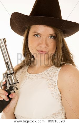 Cowgirl Holding Revolver With A Smirk On Her Face