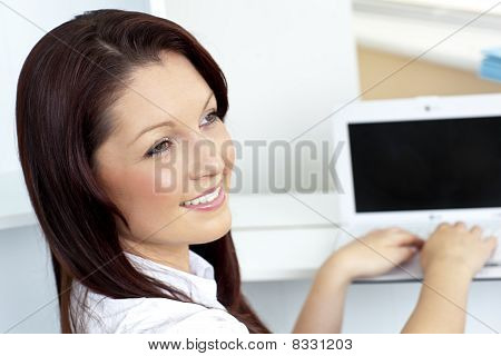 Charming Businesswoman Using Her Laptop