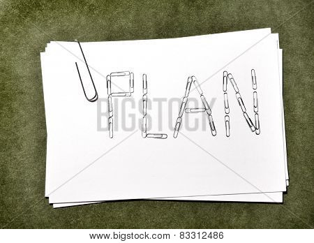White paper cards with paperclip plan for business or school on green background