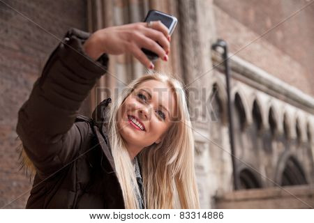 Young Blonde Woman Taking A Selfie