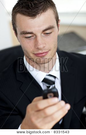 Smiling Young Businessman Sending A Message
