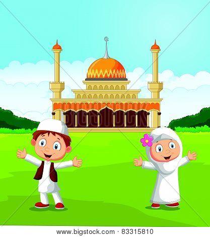 Happy cartoon Muslim kids waving hand in front of mosque