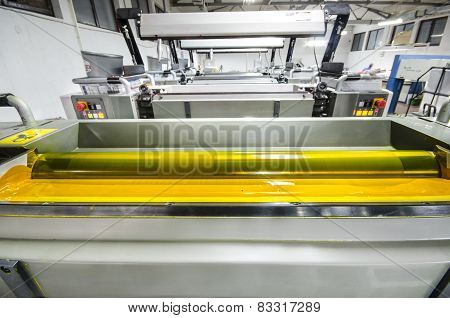 offset printing press machine rollers with yellow ink