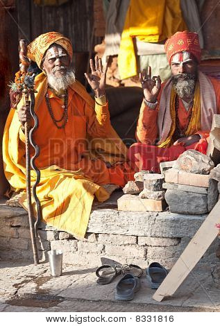 Two Sadhus Seking Alms In Pashupatinath, Nepal