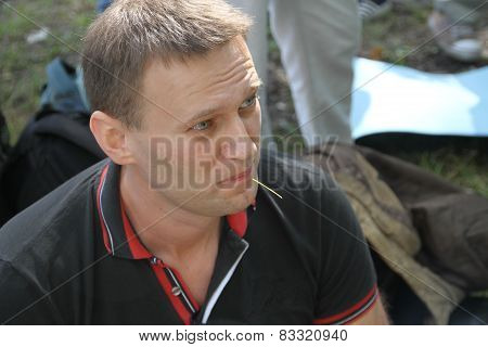 Opposition leader Alexei Navalny listens to speeches at the meeting of activists in Khimki forest.