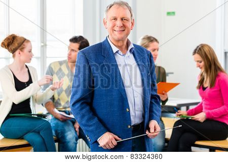 University college professor standing in class room