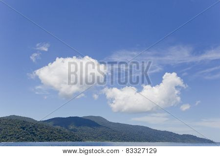 Tropical Island Beach With Sky And Clouds
