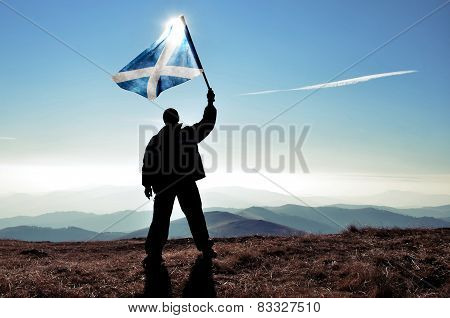 Man winner holding Scotland flag