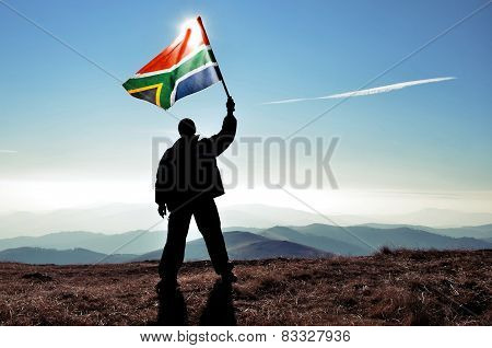 Man waving South African flag