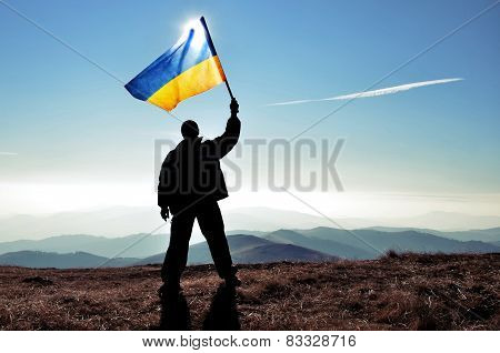 Man waving Ukrainian flag