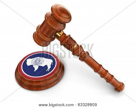 Wooden Mallet and flag Of Wyoming (clipping path included)