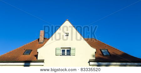 Family Home In Suburban Area With Blue Sky.