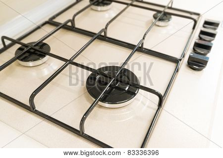 White gas stove with grill closeup