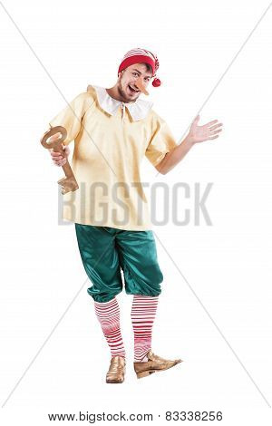 Young smiling man posing in Pinocchio costume or russian buratino
