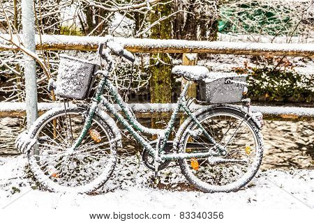 Snow Codered Bicycle Leaning At A Handrail