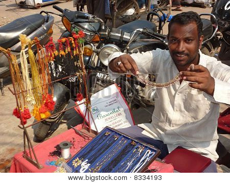 A Street Vendor Offers His Goods