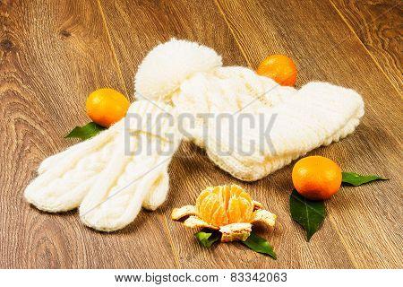 White Knitting Cap, Mittens And Tangerines