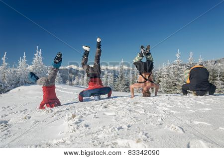 Group of skiers standing on his head on  mountain
