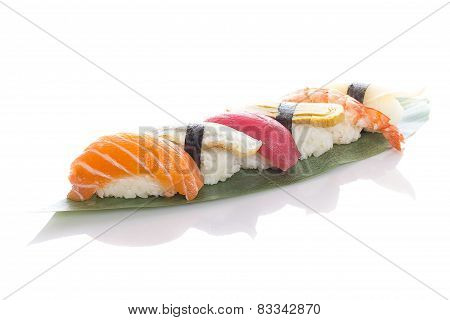 Sushi On A Bamboo List Over White Background