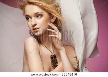 Beautiful Young Woman in Chiffon Scarf covering her head