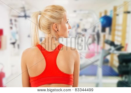 Rear View Of Young Woman In Gym