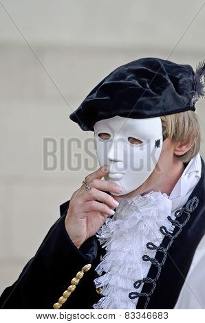 Man Wearing A Mask On His Face