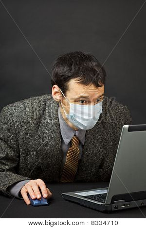 Surprised Businessman In Medical Mask Works In Internet