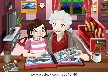 Grandma And Granddaughter Looking At Picture Album