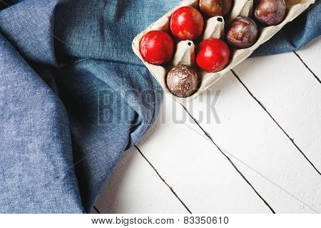 Easter Eggs On Blue Textile Draped Background