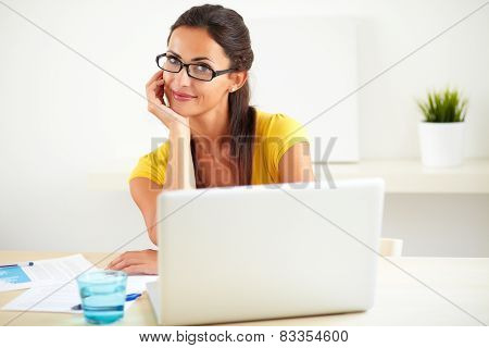 Hispanic Worker Using The Computer In Office