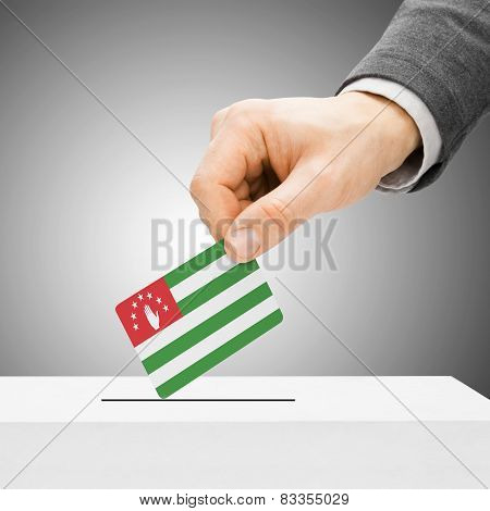 Voting Concept - Male Inserting Flag Into Ballot Box - Abkhazia