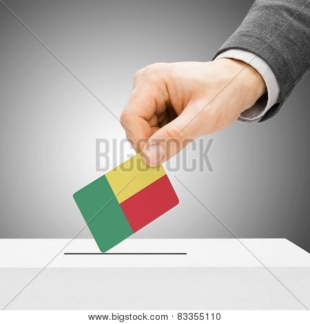 Voting Concept - Male Inserting Flag Into Ballot Box - Benin