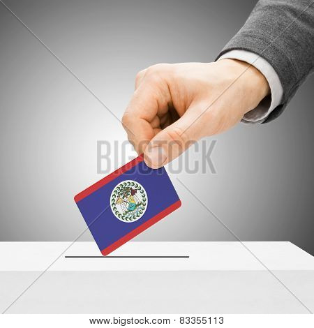 Voting Concept - Male Inserting Flag Into Ballot Box - Belize