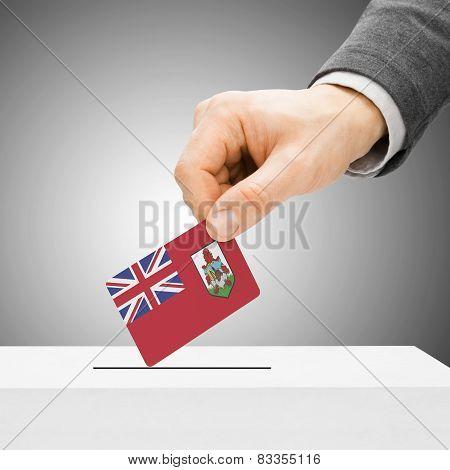Voting Concept - Male Inserting Flag Into Ballot Box - Bermuda