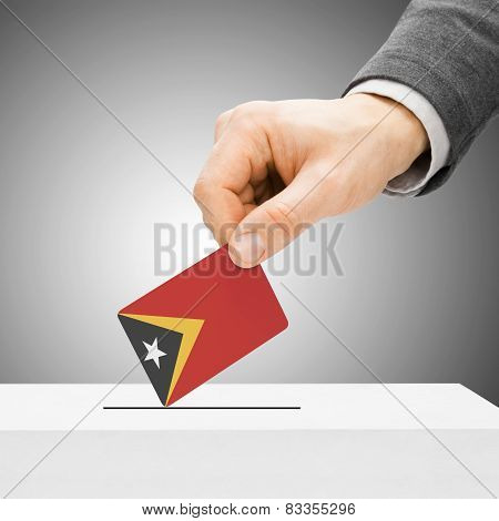 Voting Concept - Male Inserting Flag Into Ballot Box - East Timor
