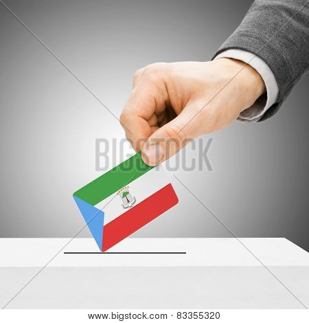 Voting Concept - Male Inserting Flag Into Ballot Box - Equatorial Guinea