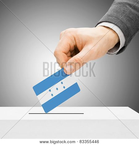 Voting Concept - Male Inserting Flag Into Ballot Box - Honduras