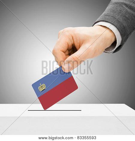 Voting Concept - Male Inserting Flag Into Ballot Box - Liechtenstein