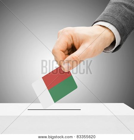 Voting Concept - Male Inserting Flag Into Ballot Box - Madagascar