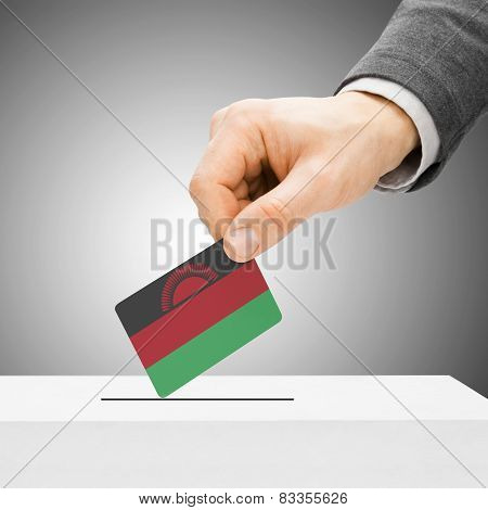 Voting Concept - Male Inserting Flag Into Ballot Box - Malawi
