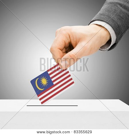 Voting Concept - Male Inserting Flag Into Ballot Box - Malaysia