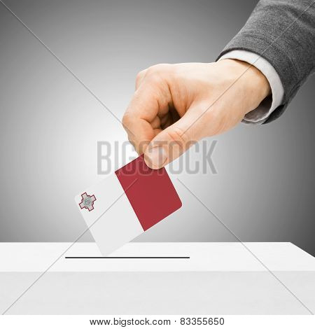 Voting Concept - Male Inserting Flag Into Ballot Box - Malta