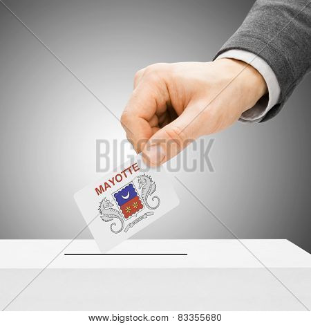Voting Concept - Male Inserting Flag Into Ballot Box - Department Of Mayotte