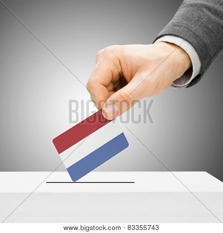 Voting Concept - Male Inserting Flag Into Ballot Box - Netherlands