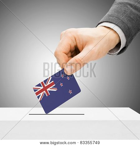 Voting Concept - Male Inserting Flag Into Ballot Box - New Zealand