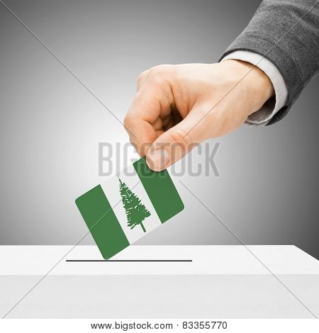 Voting Concept - Male Inserting Flag Into Ballot Box - Territory Of Norfolk Island