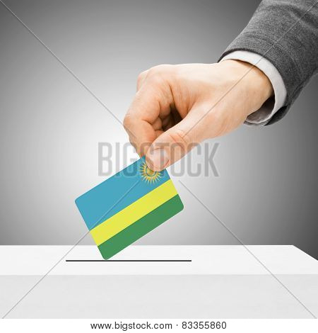 Voting Concept - Male Inserting Flag Into Ballot Box - Rwanda