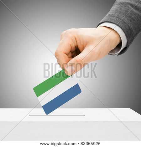 Voting Concept - Male Inserting Flag Into Ballot Box - Sierra Leone