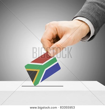 Voting Concept - Male Inserting Flag Into Ballot Box - South Africa